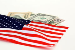 US flag and dollars. The stars and stripes with dollar bills of the USA Royalty Free Stock Photography