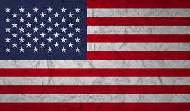 US flag with the effect of crumpled paper and grunge Stock Image