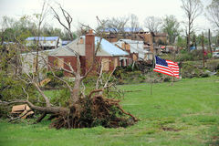 A US Flag Flies Amidst Tornado Damage. SAINT LOUIS, MISSOURI - APRIL 24: A US flag flies amidst damaged homes  after tornadoes hit the Bridgeton area on Friday Stock Images