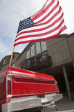 US Flag flies. Over old red chevrolet pickup truck, July 4 Independence Day Parade, Ouray, Colorado royalty free stock photos