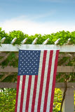 US Flag Hanging from Arbor Stock Photos