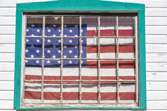 US Flag hangs on old house outside of Ouray, Colorado, Route 550, September 26, 2016 stock photography