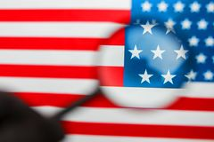 US flag looking through a magnifying glass. Study of the history and culture of the country of the United States. The concept of. Studying geography, English royalty free stock images