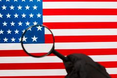 US flag looking through a magnifying glass. Study of the history and culture of the country of the United States. The concept of. Studying geography, English royalty free stock photography