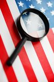 US flag looking through a magnifying glass. Study of the history and culture of the country of the United States. The concept of. Studying geography, English stock photography