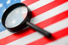 US flag looking through a magnifying glass. Study of the history and culture of the country of the United States. The concept of. Studying geography, English stock image