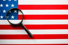 US flag looking through a magnifying glass. Study of the history and culture of the country of the United States. The concept of. Studying geography, English royalty free stock photo