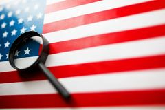 US flag looking through a magnifying glass. Study of the history and culture of the country of the United States. The concept of. Studying geography, English royalty free stock photos