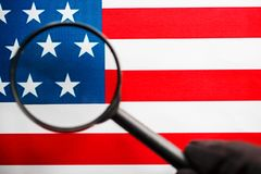 US flag looking through a magnifying glass. Study of the history and culture of the country of the United States. The concept of. Studying geography, English stock images