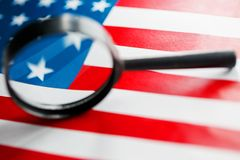 US flag looking through a magnifying glass. Study of the history and culture of the country of the United States. The concept of. Studying geography, English stock photo