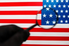 US flag looking through a magnifying glass. Study of the history and culture of the country of the United States. The. Concept of studying geography, English stock photo