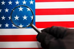 US flag looking through a magnifying glass. Study of the history and culture of the country of the United States. The. Concept of studying geography, English stock photography