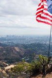 US flag with Los Angeles on the background. California Stock Images