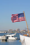 US flag in marine. US flag on the yacht background stock photography
