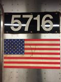 US flag on the New York metro. United States flag with the train number on a metro train in New York City royalty free stock photography