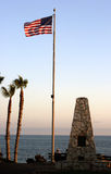 US Flag by the ocean. At sunset Royalty Free Stock Images