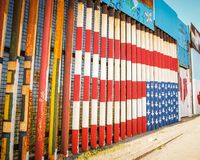 US flag painting in the border wall in Tijuana. A painting of the US flag upside down in the border wall between San Diego California and Tijuana Mexico stock photo