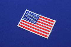 Us flag patch on  fabric Royalty Free Stock Image