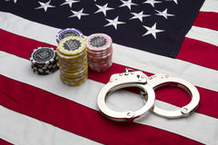US Flag with poker chips and handcuffs. A cotton US flag with poker chips and handcuffs Stock Photo