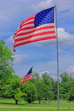 US FLAG'S MEMORIAL DAY. A US Flag with tree's , blue sky and white cloud's on Memorial day that's bright and colorful Stock Image