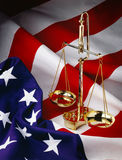 US Flag with scales. Scales of justice with American Flag Stock Images