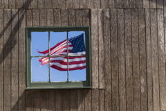 US flag. Seeing through a barn wall Royalty Free Stock Images