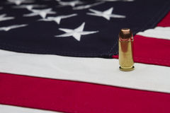 US Flag and a single bullet Royalty Free Stock Photography