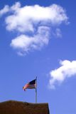 US Flag and Sky. American flag with blue sky and clouds Stock Photos