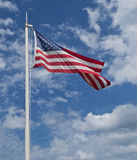 US Flag with Sky and Clouds. United States Flag with sky and clouds as background at Kings Landing Park, Huntingtown, Maryland USA royalty free stock image