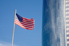 US Flag and Skyscraper Royalty Free Stock Image