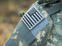US flag sleeve patch. US Army uniform element - sleeve patch with flag (ACU pattern Stock Images