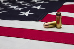 US Flag and two bullets Royalty Free Stock Images