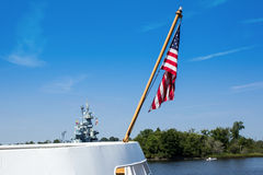 US Flag and Warship Stock Images