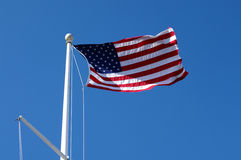 US Flag Waving in the Sky Stock Image