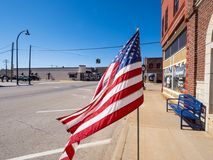 US Flag waving in the wind at Route 66 - STROUD - OKLAHOMA - OCTOBER 16, 2017 Royalty Free Stock Photo