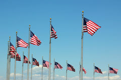 US Flags. Waving American flags against a clear blue sky Stock Image