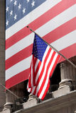 US flags. Outside the New York Stock Exchange Stock Images
