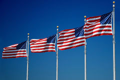 US flags flapping in wind, Washington Monument Stock Photo