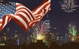 US Flags and Manhattan skyline in the night Independence day in New York City. US Flags and Manhattan skyline in the night Fourth of July Independence day in New royalty free stock photography