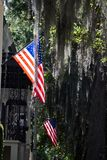 US Flags proudly displayed in Savannah, Georgia. Downtown Savannah has much to offer, the famous Jones Street is full of architecture and historic homes royalty free stock photo
