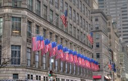 US flags in a row on a New York City building royalty free stock image