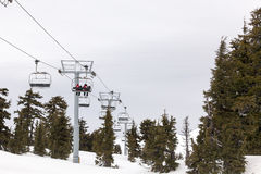 US Forest Medical Rescue Personnel Riding Ski Lift Royalty Free Stock Images