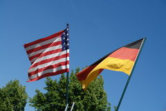 US and German Flags. A United States and a German flag hanging next to each other outside a building in Germany during the 2006 Soccer World Championship Stock Photography