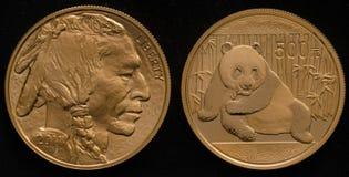 US Gold Buffalo Coin vs. China Gold Panda Coin Royalty Free Stock Images
