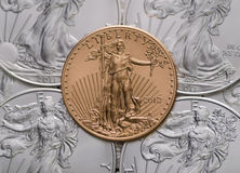 US Gold Eagle ontop of US Silver Eagles Royalty Free Stock Image