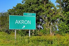 US Highway Exit Sign for Akron. Akron US Style Highway / Motorway Exit Sign for Stock Photo