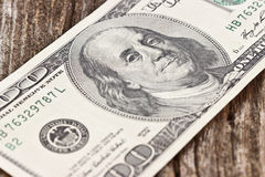 US hundred dollar bill. On the old board Stock Photo