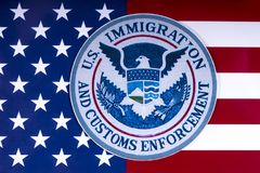 US Immigration and Customs Enforcement. LONDON, UK - MARCH 26TH 2018: The symbol of US Immigration and Customs Enforcement portrayed with the US flag, on 26th royalty free stock images