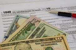 US individual tax form 2015 document. US individual tax form 1040 document 2015 with dollar notes Stock Photos