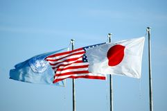 US Japan and UN Flag. Flapping in the breeze in Okinawa Japan Royalty Free Stock Photos